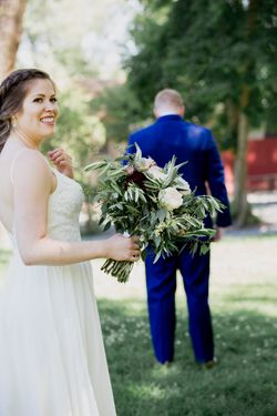Liz_Jordan_Tracy_Aviary_Salt_Lake_City_Utah_First_Look_Bride_Approaches.jpg