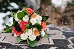 Rocky_Mountain_Bride_Winter_Elopement_Deer_Valley_Empire_Lodge_Deer_Valley_Resort_Park_City_Utah_Coral_White_Sable_Centerpiece_Reception_Table.jpg