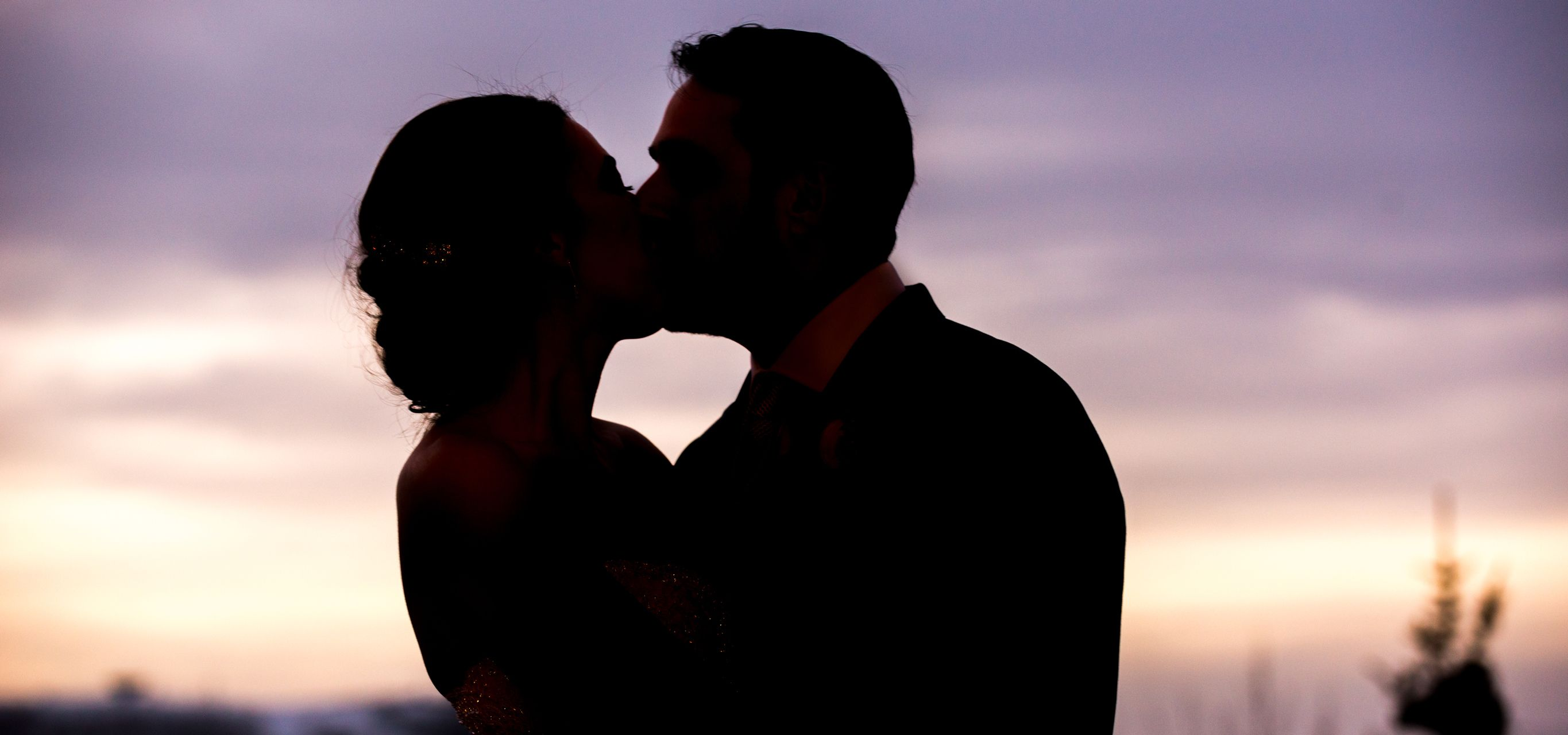 Ilana_Dave_Stein_Eriksen_Lodge_Deer_Valley_Park_City_Utah_Bride_Groom_Kissing_At_Sunset_Top_Banner.jpg