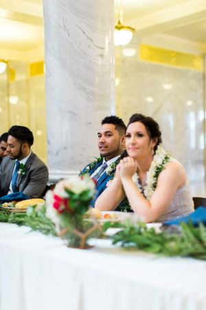 Tessa_Taani_Utah_State_Capitol_Salt_Lake_City_Utah_Happy_Bride_Groom_Seated_at_Head_Table.jpg