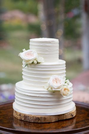 Evelyn_Kevin_Park_City_Utah_Wedding_Cake_Delicately_Adorned_With_White_Roses.jpg