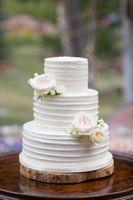 Evelyn_Kevin_Park_City_Utah_Wedding_Cake_Delicately_Adorned_With_White_Roses.jpg