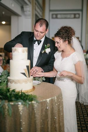 Chloe_Austin_Ben_Lomond_Suites_Ogden_Utah_Great_Gatsby_Cutting_Wedding_Cake.jpg
