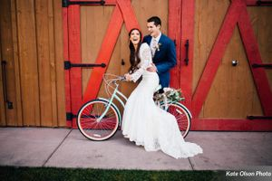 Charming_Barn_Wedding_Quiet_Meadow_Farms_Mapleton_Utah_Bride_Riding_Bicycle.jpg