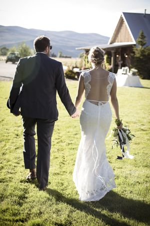 McCall_Brad_High_Star_Ranch_Kamas_Utah_Bride_Groom_Hand_in_Hand.jpg