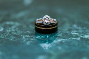 Katelyn_David_Wedding_Rings_Highlighted_by_Warm_Green_Marble.jpg