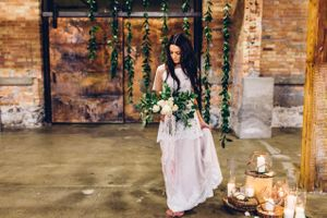 Modern_Industrial_Wedding_Shoot_The_Historic_Startup_Building_Provo_Utah_Accent_Candles_Simple_Backdrop.jpg