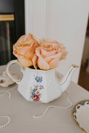 Tea_Party_Baby_Shower_Provo_Utah_Pastel_Orange_Roses_in_Teapot.jpg
