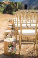 Kristin_Haven_Blacksmith_Fork_Canyon_Hyrum_Utah_Ceremony_Gold_Chiavari_Chairs_Wood_Stump_Decor.jpg