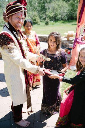 Reema_Spencer_Temple_Har_Shalom_Park_City_Utah_Giving_Children_Money.jpg