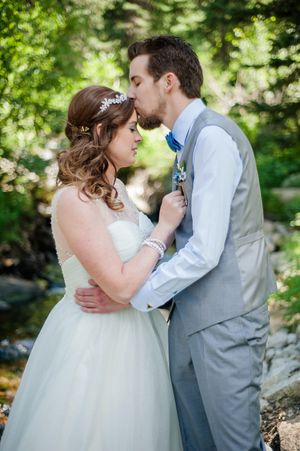 Ashley_Dan_Solitude_Resort_Solitude_Utah_Groom_Kissing_Bride_in_the_Woods.jpg