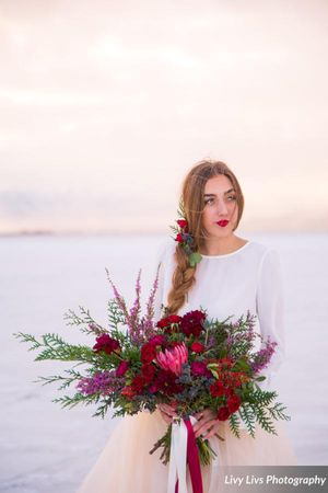 Salt_Air_Wedding_Shoot_Saltair_Resort_Salt_Lake_City_Utah_Bride_with_Stunning_Floral_Display.jpg