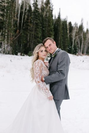 Rocky_Mountain_Bride_Winter_Elopement_Deer_Valley_Empire_Lodge_Deer_Valley_Resort_Park_City_Utah_Bride_Groom_Embrace_Snow.jpg