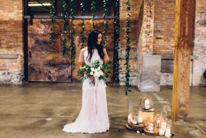 Modern_Industrial_Wedding_Shoot_The_Historic_Startup_Building_Provo_Utah_Simple_Greenery_Bride_Candles.jpg