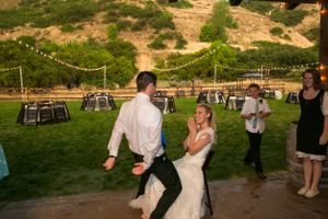 Tori_Sterling_Quiet_Meadow_Farms_Mapleton_Utah_Groom_Approaches_Bride_For_Garter.jpg