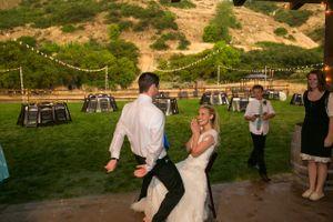 Tori_Sterling_Quiet_Meadow_Farms_Mapleton_Utah_Groom_Approaches_Bride_For_Garter.jpg