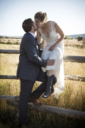 McCall_Brad_High_Star_Ranch_Kamas_Utah_Bride_Groom_Kissing_Fence.jpg