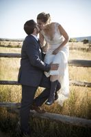McCall_Brad_High_Star_Ranch_Kamas_Utah_Bride_Groom_Kissing_Fence.jpg