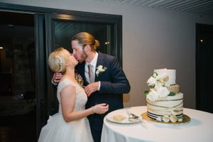 Tasha_Chip_Salt_Lake_City_Utah_Couple_Kissing_After_Cake_Cutting.jpg