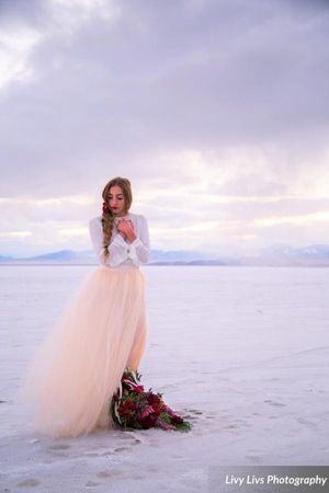 Salt_Air_Wedding_Shoot_Saltair_Resort_Salt_Lake_City_Utah_Bride_on_Salt_Flats_with_Bright_Floral_Bouquet.jpg
