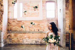 Modern_Industrial_Wedding_Shoot_The_Historic_Startup_Building_Provo_Utah_Bride_Hanging_Vases.jpg