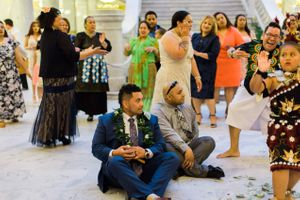Tessa_Taani_Utah_State_Capitol_Salt_Lake_City_Utah_Groom_Seated_on_Floor_With_Leis.jpg