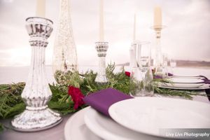 Salt_Air_Wedding_Shoot_Saltair_Resort_Salt_Lake_City_Utah_Elegant_Table_Setting_Silver_Candlesticks_Stormy_Background.jpg