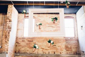 Modern_Industrial_Wedding_Shoot_The_Historic_Startup_Building_Provo_Utah_Framed_Hanging_Vases.jpg