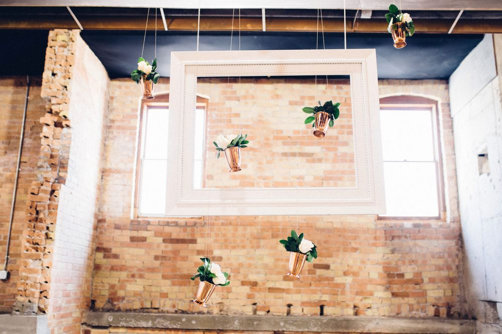 Modern_Industrial_Wedding_Shoot_The_Historic_Startup_Building_Provo_Utah_Framed_Hanging_Vases.jpg