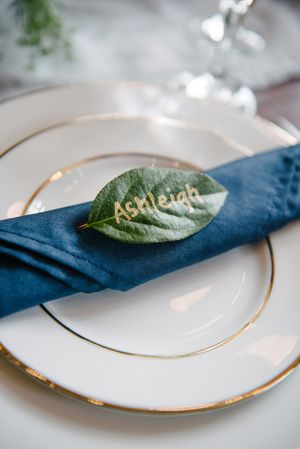 "Rocky_Mountain_Bride_Winter_Elopement_Deer_Valley_Empire_Lodge_Deer_Valley_Resort_Park_City_Utah_Table_Detail_Silver_Rimmed_Dish_Blue_Napking_""Ashleigh""_Leaf.jpg"