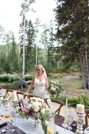 Evelyn_Kevin_Park_City_Utah_Bride_Admiring_Elegant_Table_Setting.jpg