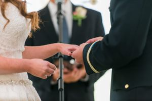 Katelyn_David_Park_City_Utah_Placing_Ring_on_Bride's_Finger.jpg