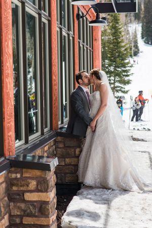 Ilana_Dave_Canyon_Resort_Park_City_Utah_Bride_and_Groom_Kissing_Outside-Lodge.jpg