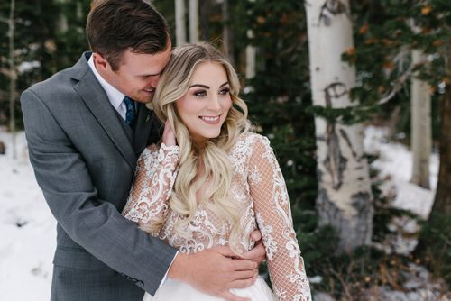 Rocky_Mountain_Bride_Winter_Elopement_Deer_Valley_Empire_Lodge_Deer_Valley_Resort_Park_City_Utah_Groom_Embracing_Bride.jpg