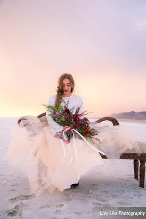Salt_Air_Wedding_Shoot_Saltair_Resort_Salt_Lake_City_Utah_Bride_Sitting_on_Fainting_Couch_with_Bouquet.jpg