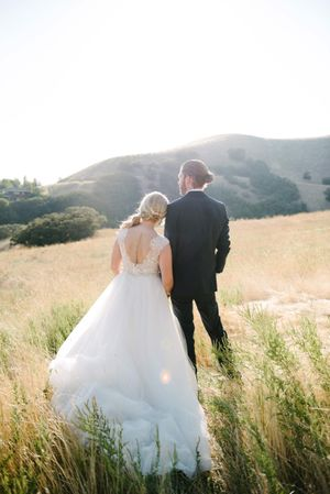 Tasha_Chip_Salt_Lake_City_Utah_Couple_in_Field_Looking_Away.jpg