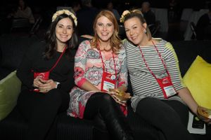Higher_Education_User_Group_2018_Salt_Palace_Convention_Center_Salt_Lake_City_Utah_Three_Smiling_Women_Comfortable_on_Couch.jpg