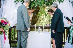 Claire_Scott_Millcreek_Inn_Salt_Lake_City_Utah_Parents_Light_Candles.jpg