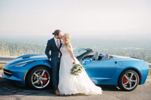 Tasha_Chip_Salt_Lake_City_Utah_Bride_Groom_Kissing_Shiny_Blue_Corvette.jpg