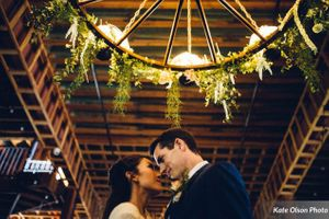 Charming_Barn_Wedding_Quiet_Meadow_Farms_Mapleton_Utah_Couple_Wagon_Wheel.jpg