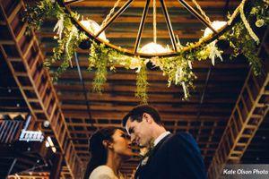Charming_Barn_Wedding_Quiet_Meadow_Farms_Mapleton_Utah_Couple_Wagon_Wheel.jpg