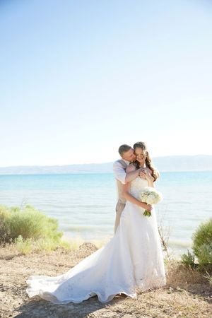 Aspyn_Steven_Bear_Lake_Utah_Couple_Embrace_Lakeside.jpg