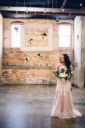 Modern_Industrial_Wedding_Shoot_The_Historic_Startup_Building_Provo_Utah_Beautiful_Bride_Hanging_Vase_Backdrop.jpg