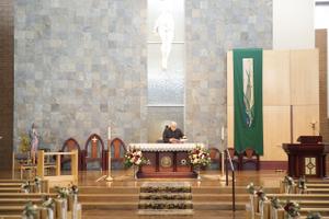 Tina_Dan_Snowbird_Resort_Priest_Preparing_Church.jpg