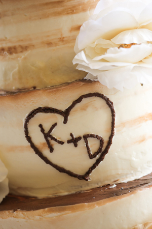 Tina_Dan_Snowbird_Resort_Wedding_Cake_Carved_Initials.jpg