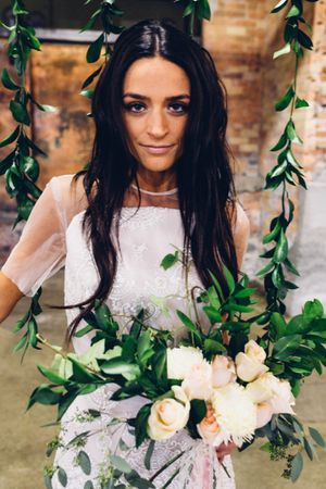 Modern_Industrial_Wedding_Shoot_The_Historic_Startup_Building_Provo_Utah_Bride_White_Flower_Bouquet.jpg