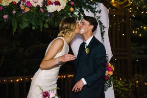 Claire_Scott_Millcreek_Inn_Salt_Lake_City_Utah_Kiss_After_Cutting_Cake.jpg