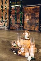 Modern_Industrial_Wedding_Shoot_The_Historic_Startup_Building_Provo_Utah_Greenery_Backdrop_Glowing_Candles.jpg
