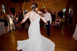 Liz_Jordan_Tracy_Aviary_Salt_Lake_City_Utah_Wedding_Celebration_Flowing_Dress.jpg