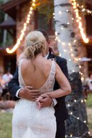 Evelyn_Kevin_Park_City_Utah_Couple_Embracing_Bistro_Twinkle_Lights.jpg